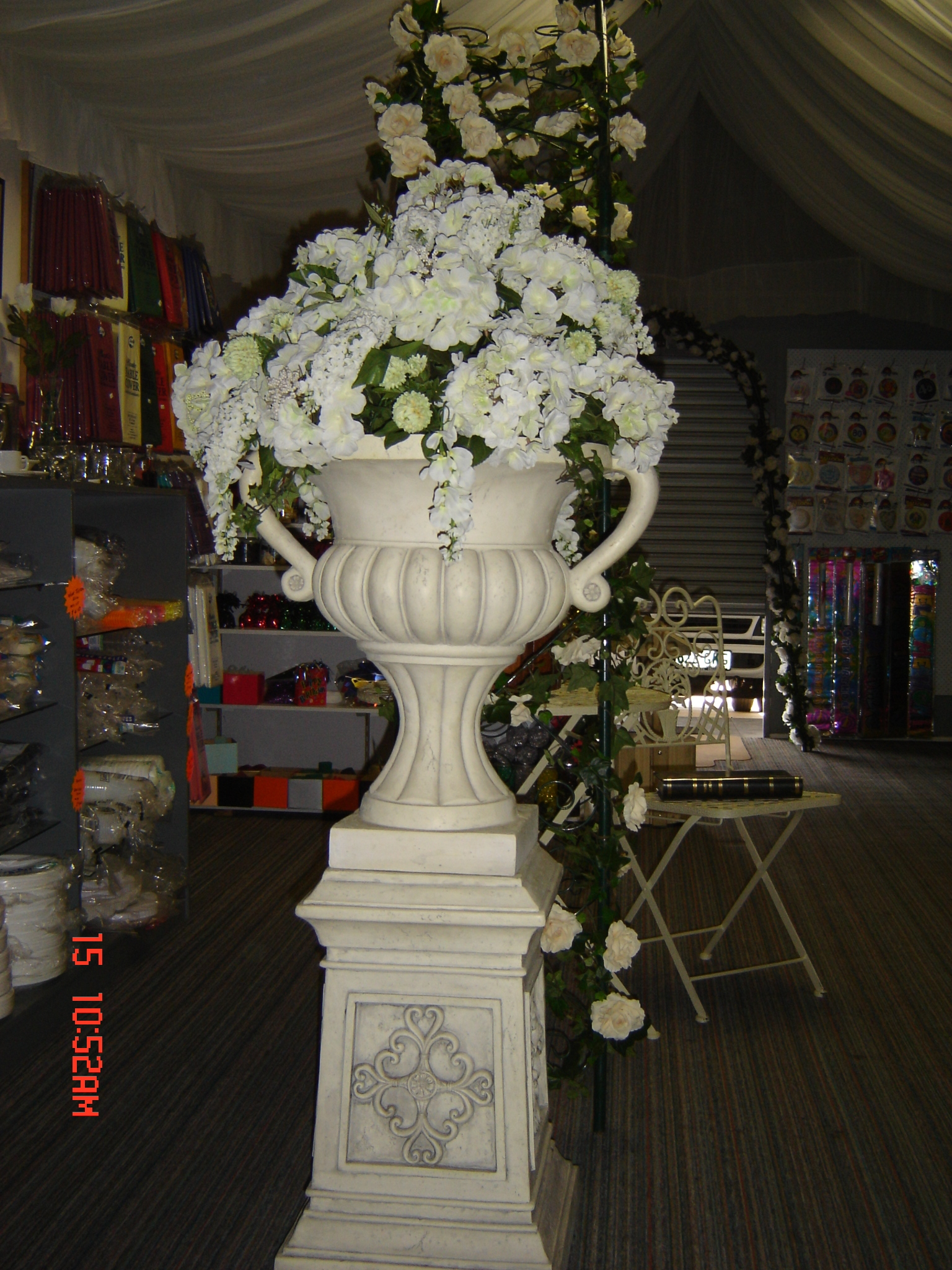 Room decor complete party and marquee hire brisbane redcliffe floral arrangement with pedestal urn junglespirit Image collections
